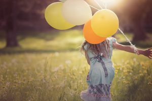 Happiness: Girl with balloons.